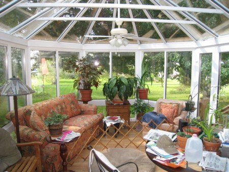 Vinyl Conservatory with large sliding windows and doors