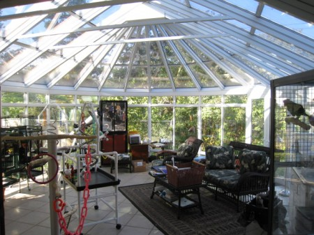 Expansive aluminum conservatory with sliding windows and French doors
